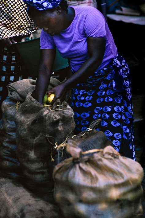 Woman in Blue with Yellow Fruit, Liberia