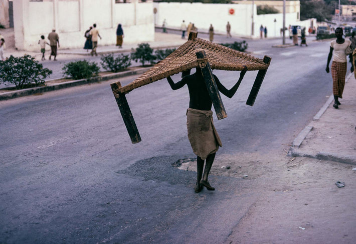 Man Carrying Bed, Somalia