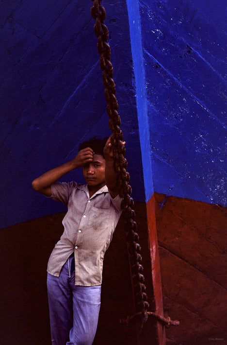 Young Man, Red and Blue Boat, Jakarta