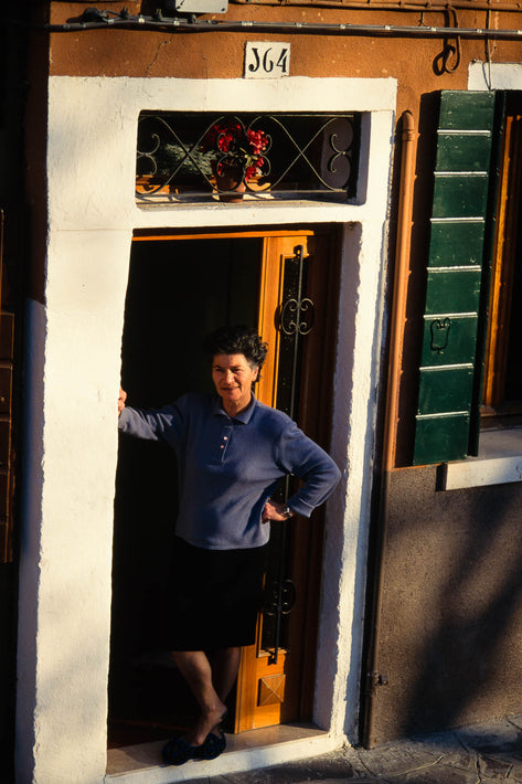 Woman in Doorway in Blue Top, Burano