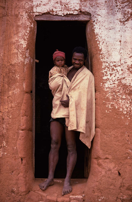 Man and Child in Doorway