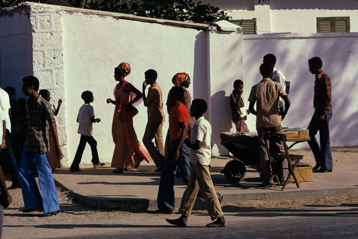 People Walking Against White Wall, Somalia