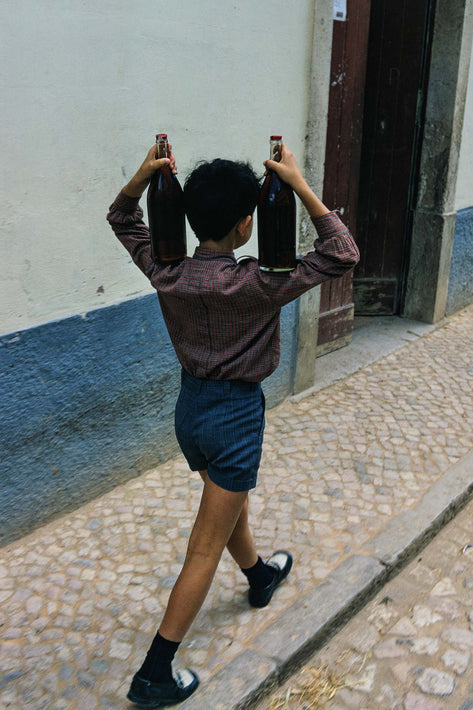 Boy with Two Bottles of Wine, Portugal