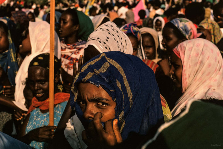 Woman in Crowd, Hand to Face, Somalia