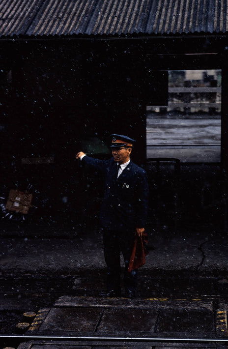 Railroad Conductor in Snow, Japan
