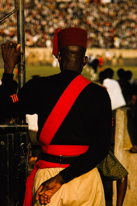 Man with Red Sash in Focus, Ghana