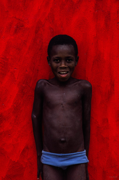 Young Boy, Blue Trunks, Red Red Wall, Bahia