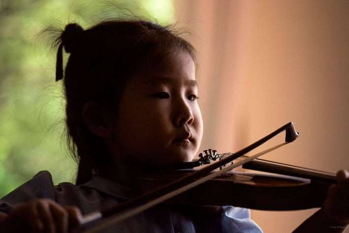 Closeup of Child Playing Violin, Kamakura