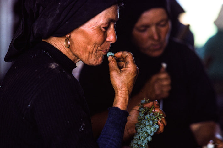 Woman with Grape to Mouth, Portugal