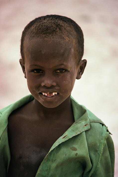 Young Boy in Green, Missing Teeth, Somalia