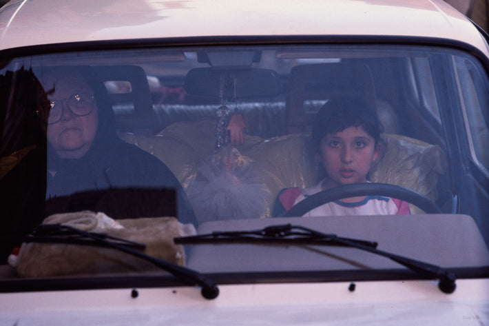Older Woman and Young Girl in Car, Egypt