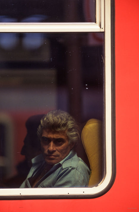 Man with Grey Hair in Train Window, Milan