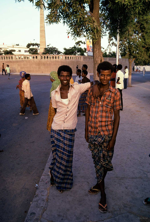 Two Young Men Posing, One with Arm on Shoulder, Somalia