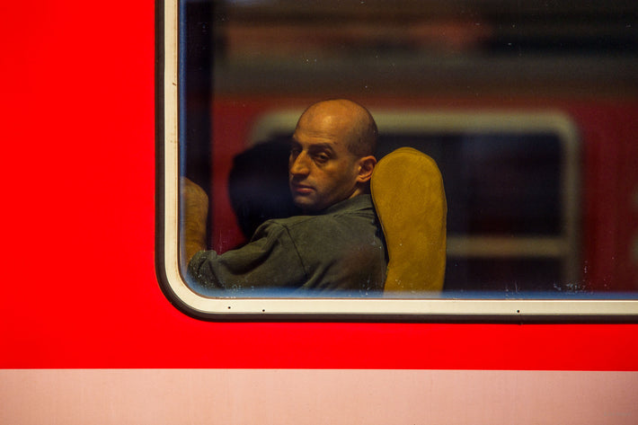 Bald Man in Train Window, Milan