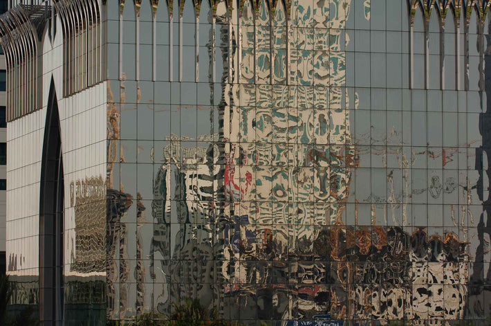 Reflection in Glass Building with Arch on Right, Dubai