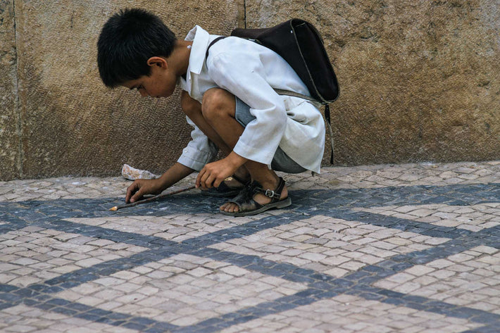 Boy Kneeling in White, Portugal