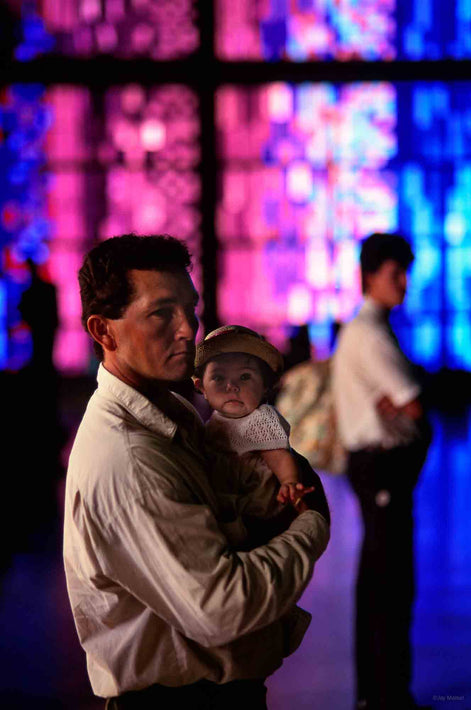 Man Holding Baby with Red and Blue Windows, Rio de Janeiro