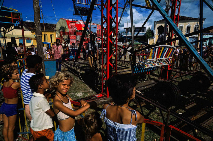 "Blonde Girl and Other Children at ""Fair"" Rides, Bahia"