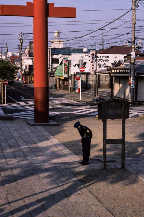 Policeman Bowing (To No One) in Street, Kamakura