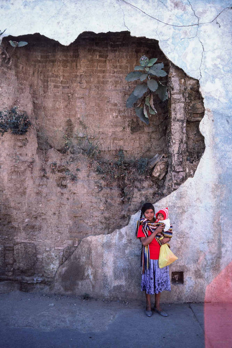 Woman and Baby Against Fragmented Wall, Oaxaca