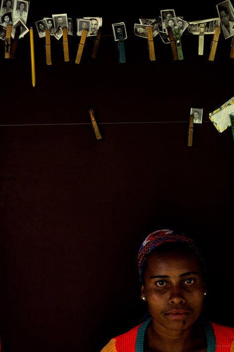 Woman Against Black with Pictures on Clothespins, Bahia