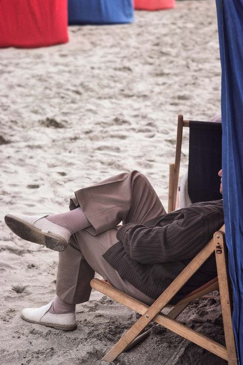 Fully Clothed Man at Beach in Chair