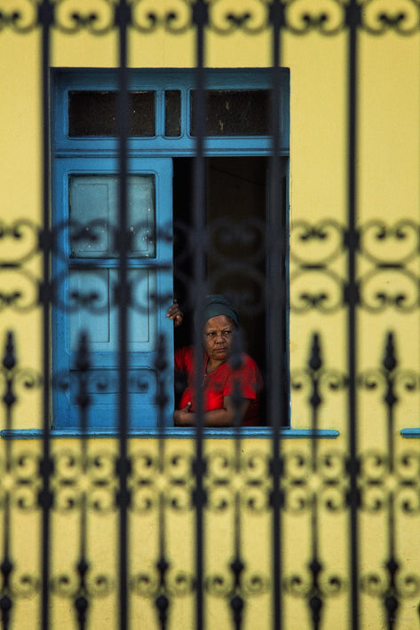 Woman in Red, Yellow Wall, Fence in Foreground, Bahia