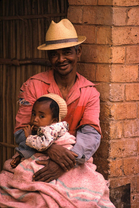 Man in Pink with Baby