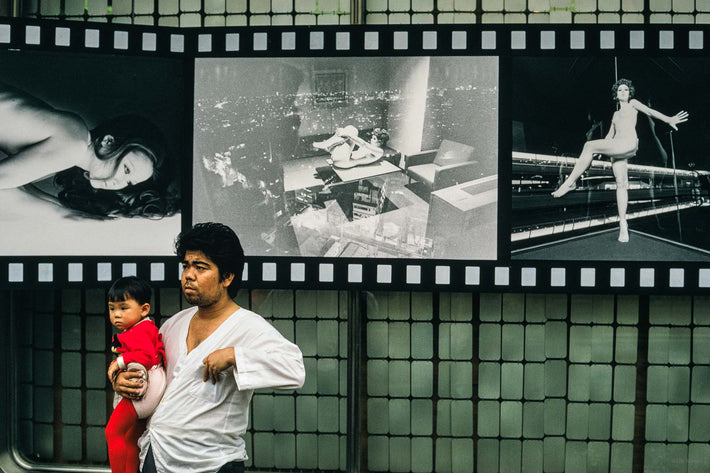 Man, Baby in Red, Photos on Wall, Tokyo
