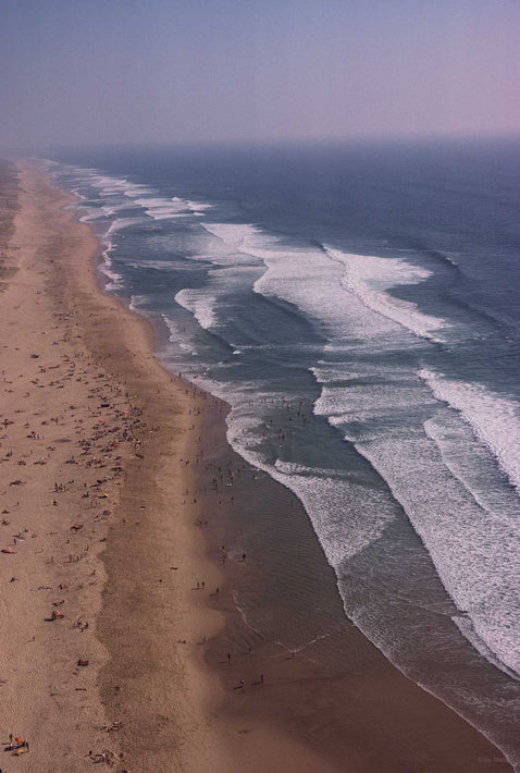 Aerial of Surf, Sea, Beach Vertical