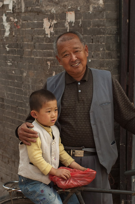 Man with Arm Around Child, Pingyao