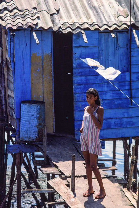 Young Girl, Striped Dress Against Blue Shack, Bahia