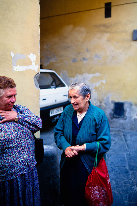 Two Women Talking, One Hand to Neck and One with Hands Clasped, Cortona