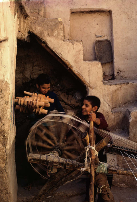 Two Boys with Spinning Wheel, Iran