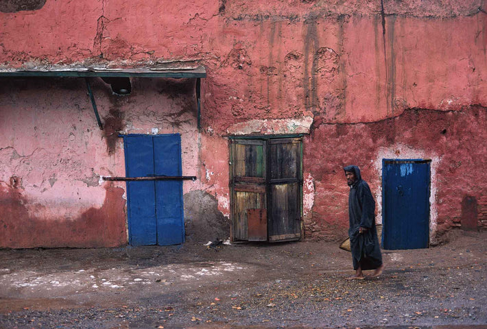 Man in Dark Djellaba with Blue Doors and Pink Walls, Marrakech