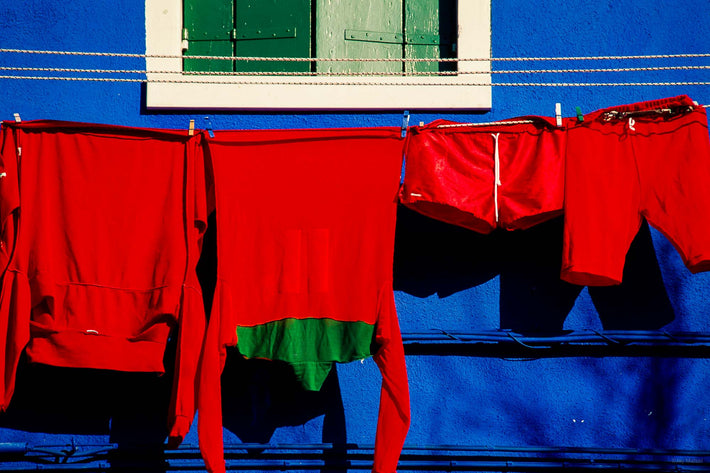 Red Laundry Against Blue Building, Burano