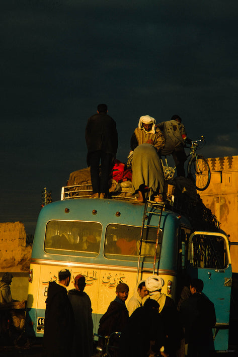 Bus with Silhouetted Men with Men on Top, Marrakech