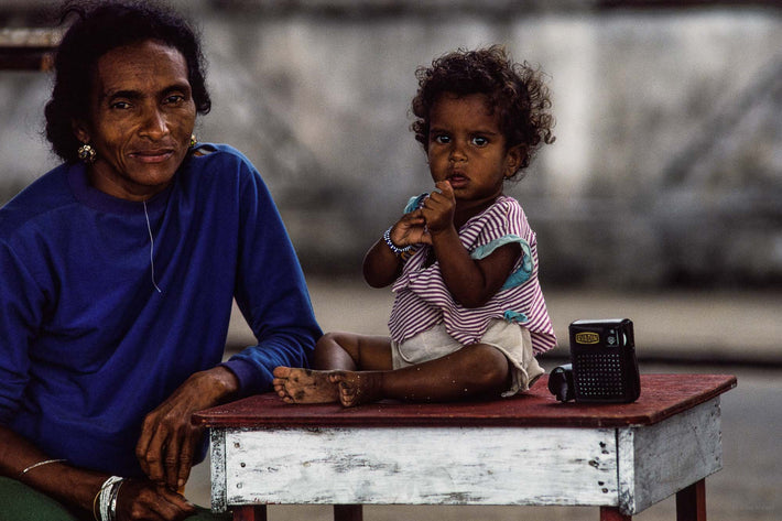 Mother in Blue, Child on Table, Bahia