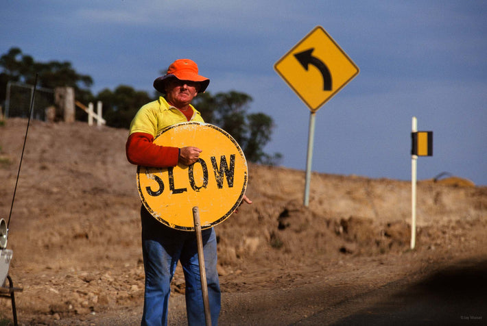 "Man with Traffic Sign, ""Slow"", Australia"
