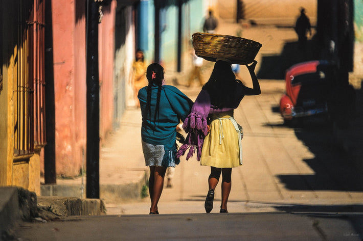 Two Women, One with Basket on Head, San Cristobal