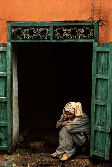 Man Sitting in Open Doorway with Arms on Knees, Marrakech