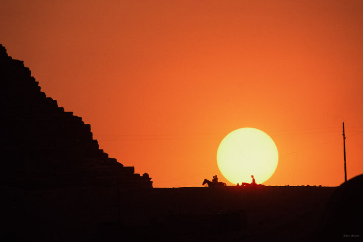 One side of Pyramid with Sun, Two Horses, Egypt