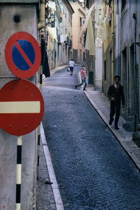 Street with Traffic Signs, Three People, Portugal
