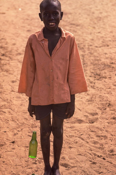 Boy with Green Bottle, Senegal