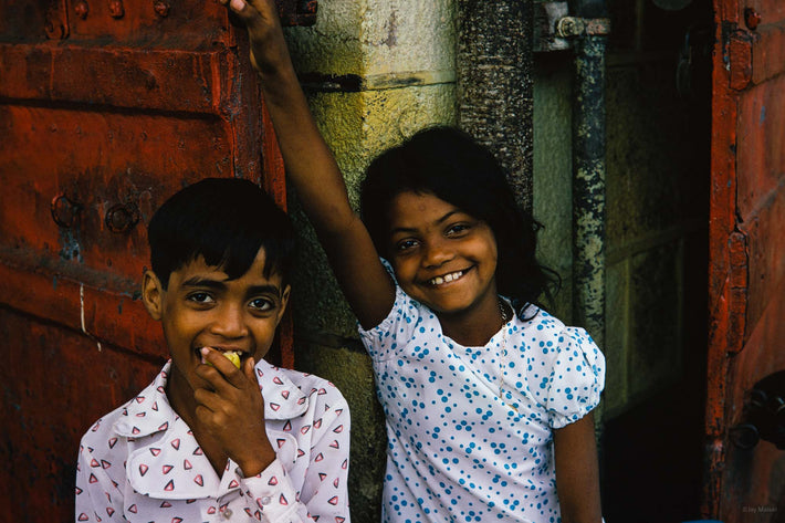 Two Kids, One Eating, One Smiling, Mauritius