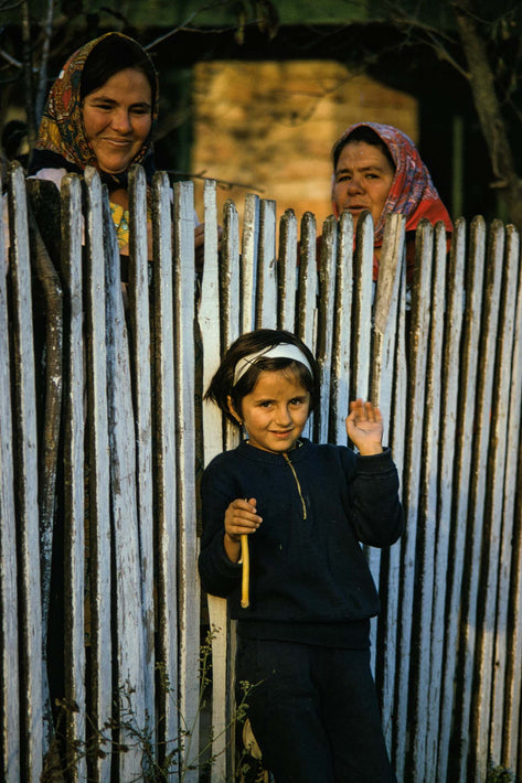 Child, Two Women and Fence