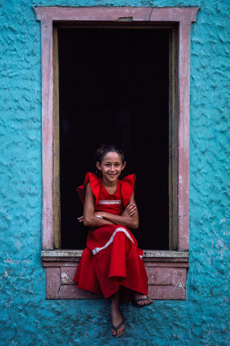 Girl in Red Against Black, Teal Blue Walls, Bahia
