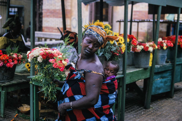Woman with Baby and Flowers, Ghana