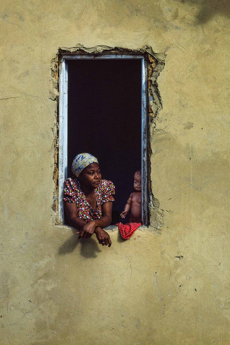 Woman with Doll in Window, Yellowish Wall, Bahia