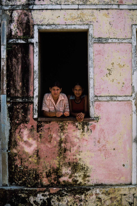 Two Girls in Window, Textured Outer Wall, Bahia
